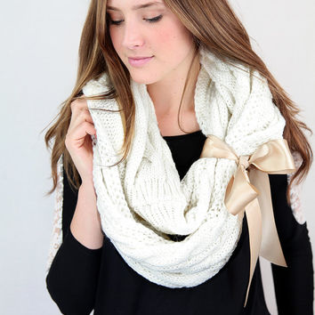 chunky knit winter white infinity scarf with large satin bow cuff, white cable knit