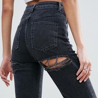 ASOS FARLEIGH High Waist Slim Mom Jeans in Washed Black with Bum Rips at asos.com