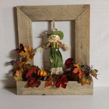 Fall Window Box with Fall Foliage and Scarecrow Made from Repurposed Pallet Wood