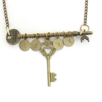 Wire wrapped bronze skeleton key necklace, hand stamped LOVE, antiqued bronze chain.