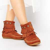 Minnetonka Double Fringe Coin Detail Boots at asos.com