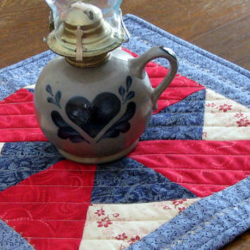 Quilted Candle Mat, double pinwheel pattern, in red, white and blue