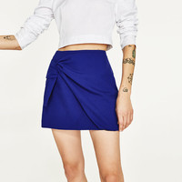 MINI SKIRT WITH KNOT DETAILS