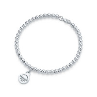 Tiffany & Co. - Return to Tiffany™ mini round tag in sterling silver on a bead bracelet.