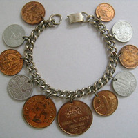 "Canada, South Africa, Pakistan, Republik Osterreich, Helvetia, Silvertone Chain 11 Genuine Coin Charm Bracelet 7 1/2"" Long Clasp Signed STAR"