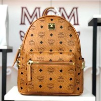 MCM street fashion men and women casual wild large capacity side rivet backpack brown