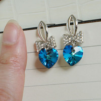 silver ribbon with a dangle blue heart shape crystal earring