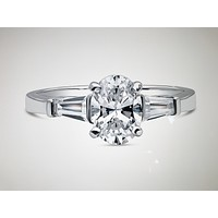 A Classic 1.3CT Oval Cut Russian Lab Diamond Engagement Ring with Baguettes