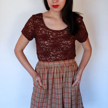 30% OFF. MOVING SALE. 1960s-1970s. brown high waist. plaid skirt with ruffle. extra small-small