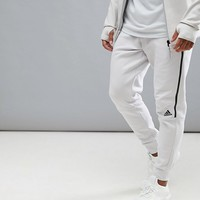 adidas ZNE Striker Pants In Cream CG2188 at asos.com