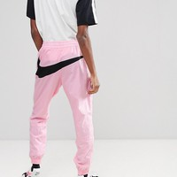 Nike Vaporwave Joggers With Large Swoosh In Pink AJ2300-686 at asos.com