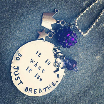 "Unique hand stamped, ""it is what it is so just breathe"" necklace and a princess crown and star charms accents"