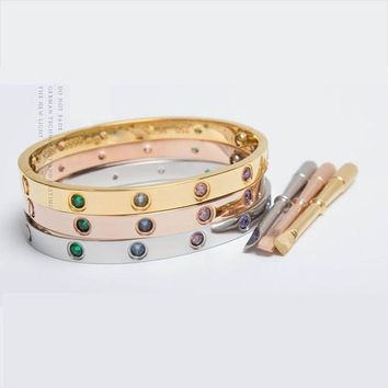 One-nice? Multu Color Cartier Style locking bracelet with key
