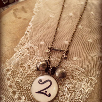 Steampunk Neo Victorian Necklace. Brass chain and resin bezel. Old tribal findings and alchemy symbol. Esoteric Jewelry. Gold Five
