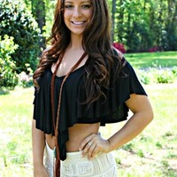 Black crop top with ruffle neck.