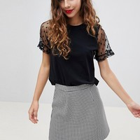 ASOS DESIGN t-shirt with dobby ruffle sleeve at asos.com