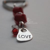 Red beaded key chain with Love charm and gems on heart shaped ring