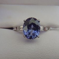 18 KT W/GOLD 3.05 ct OVAL BLUE SAPPHIRE & DIAMOND RING - eBay (item 250817207605 end time Jun-07-11 14:45:16 PDT)