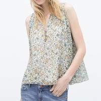 Green Floral Print V-Neck Sleeveless Ruffle Blouse