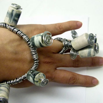 Cuff and ring set ,  black and white swirled porcelain cylinder beads in a thick aluminum wire wrap. modern high fashion design, art jewelry