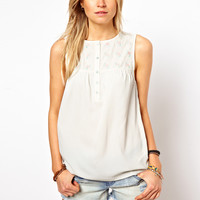 ASOS Sleeveless Blouse With Floral Embroidered Yoke at asos.com