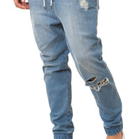 The Distressed Denim Jogger Pants in Medium Wash