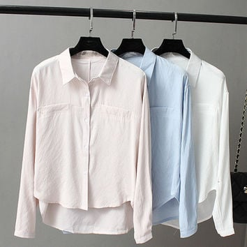 Blouse cotton and linen loose thin is prevented bask in a shirt
