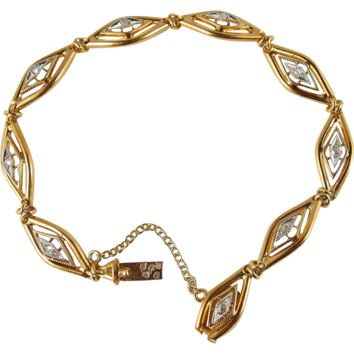 Rare antique bracelet astride the Art Nouveau/Art Déco periods in 18K stamped solid gold and rose cut diamonds, bicolor filigree and geometric design