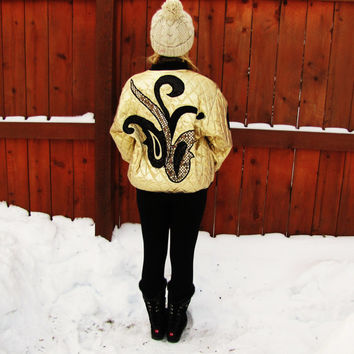 one of a kind shimmering gold metallic jacket with gold and black sequence. quilted gold metallic bomber jacket