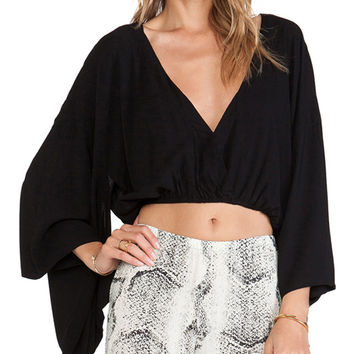 Black Plunging V-Neckline Flare Sleeve Crop Top