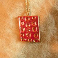 Fused Glass Necklace, dichroic, red, firery looking, black back, unique, rectangle rectangular clear glass shiny shinning gold plaited chain