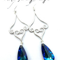 Silver filigree drops, sterling silver ear wires, and Blue Swarovski crystal earrings.