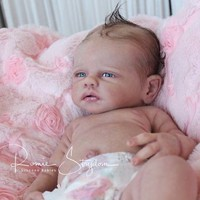 A Romie Baby*Full Bodied solid SILICONE doll sculpted & reborn by Romie Strydom