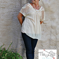 Cream short sleeve top with knit neckline