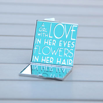A girl with love in her eyes and flowers in her hair | Customizable love quote mirror | Unique gift idea for her