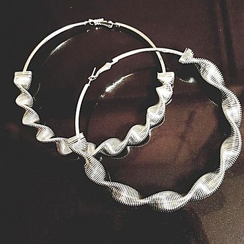 Large spiral hoop earrings