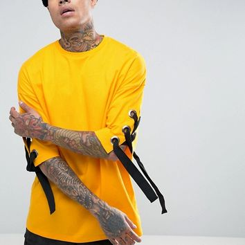 ASOS Oversized T-Shirt With Chunky Eyelet Lace Up Sleeves In Yellow In Heavy Jersey at asos.com