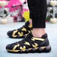 Black and Gold Cross Strap Sneakers with Bubble Soles