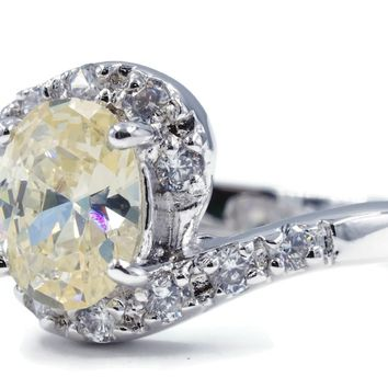 Stunning Offset Twist Silvertone Fashion Ring with Oval Pale Yellow CZ AND Clear Stones