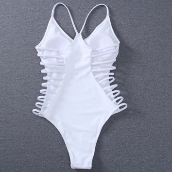The new one - piece swimsuit female solid color sexy hollow swimsuit