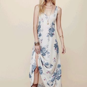 Add a bit of floral for the new season in the Floral Print Cinched Slip Dress by Free People. This super soft sleeveless maxi dress features soft stretch rayon, floral print throughout, deep v-neckline, shoulder straps, pleated at bodice, scoop back, and f