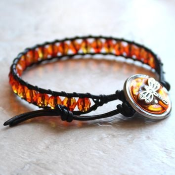 Orange Czech glass, leather wrap, bracelet with dragonfly button closure