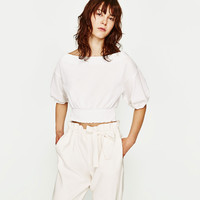 TOP WITH SHIRRED HEM