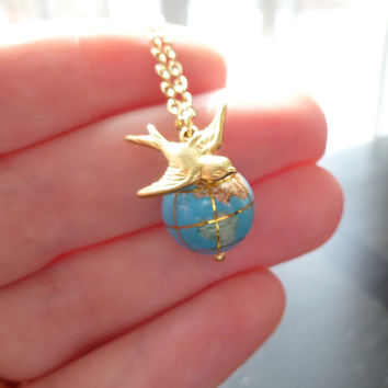 World globe necklace - small gemstone Earth bead and traveling brass bird on delicate gold plated chain - You're Not So Far Away