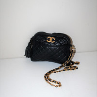 padded black leather chain strap purse 1980s vintage designer crossbody bag