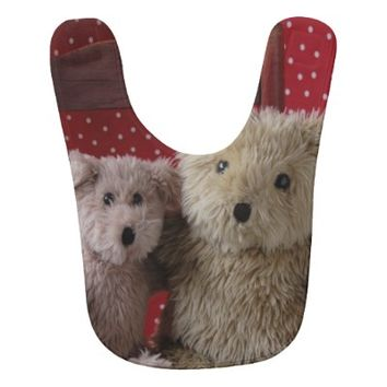 Two teddy bears in a red chair