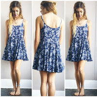 A Navy Frilly Flower Sundress.