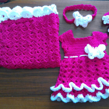 Crochet baby blanket, dress, shoes and headband in hot pink and white colors with crochet butterflies