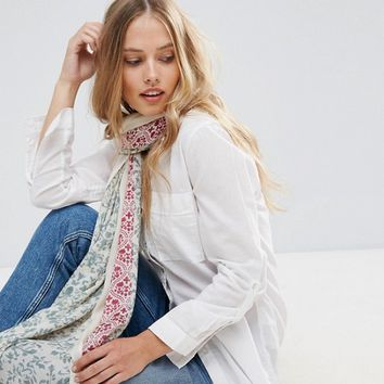 Yumi Two Tone Floral Scarf with Tassel Trim at asos.com
