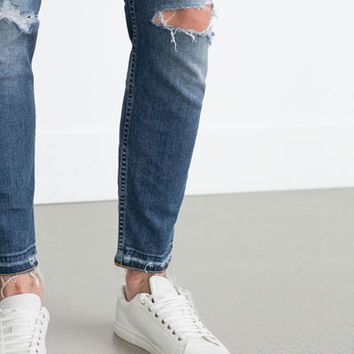 SKINNY JEANS WITH FRAYED HEM